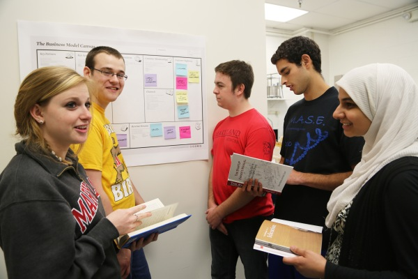 UMD students working with a business model canvas